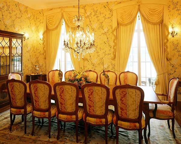 Formal dining room with extensive drapery seats 12 people