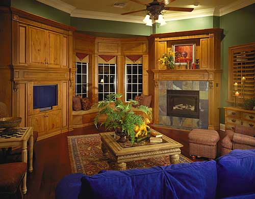 Picture of the family room with extensive built-in wood cabinets and shelving. Includes fireplace.