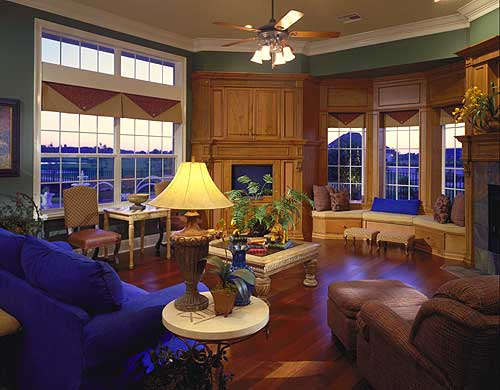 Large sitting room with wood flooring and built in wood cabinetry