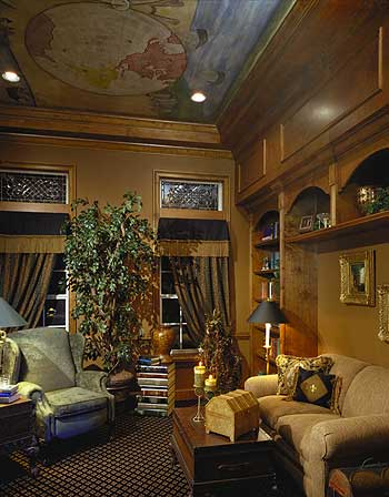 Luxuriously decorated family room with extensive use of wood and mural ceiling