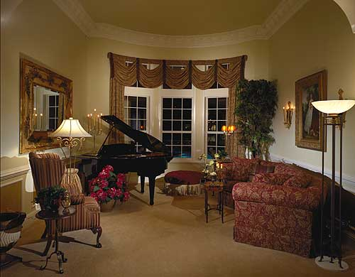 Formal living room with fireplace and baby grand piano