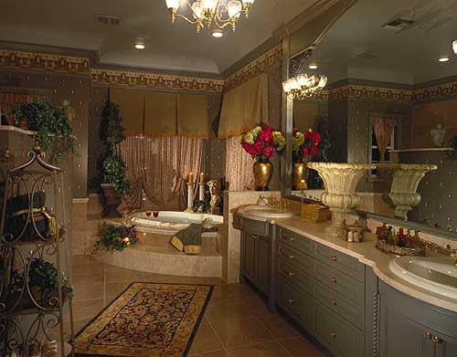 Luxuriously designed and spacious master bathroom with two sinks, sunken tub and mood lighting