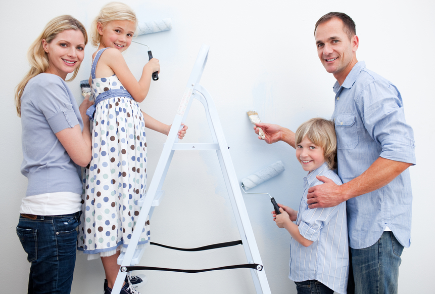 Family painting a living room