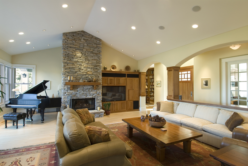 Large formal living room with fireplace and grand piano
