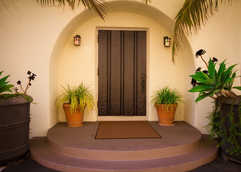 dark brown front door recessed into the front foyer - Entrance Doors Designs