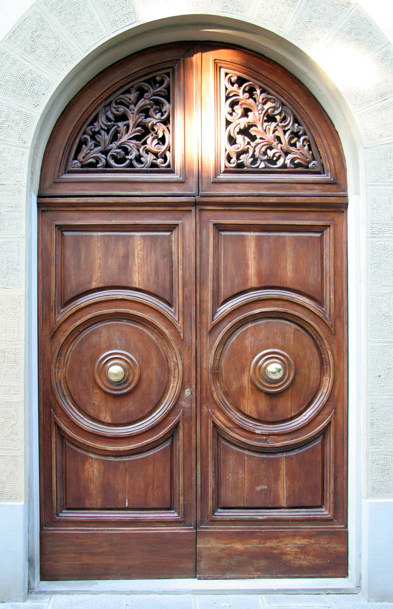 Beau Large Arched Wooden Front Door Design With Intricate Carving Detail