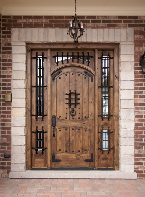 Intricate wood door with iron work. 58 Types of Front Door Designs for Houses  Photos