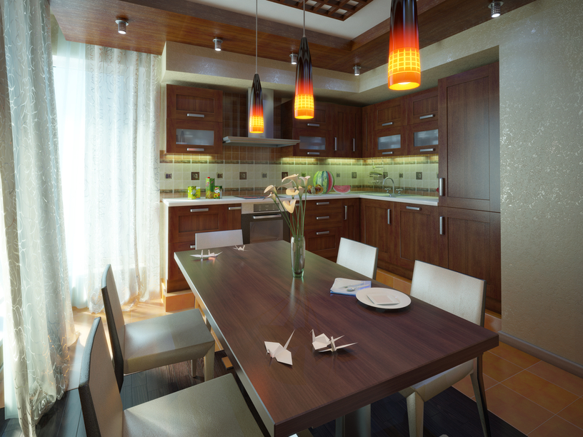 Dining table illuminated with orange and yellow pendant lighting