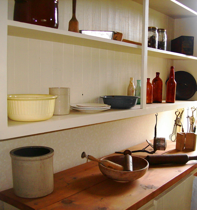 White kitchen shelves with dishes