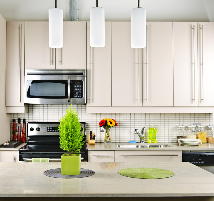 White kitchen with 3 white glass pendant lights