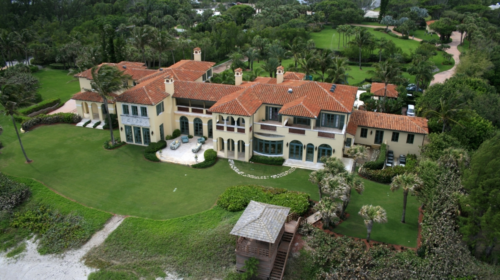 Aerial view of large Florida beach mansion with extensive grounds