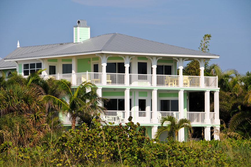 2-story beach house with columns and full-width decks