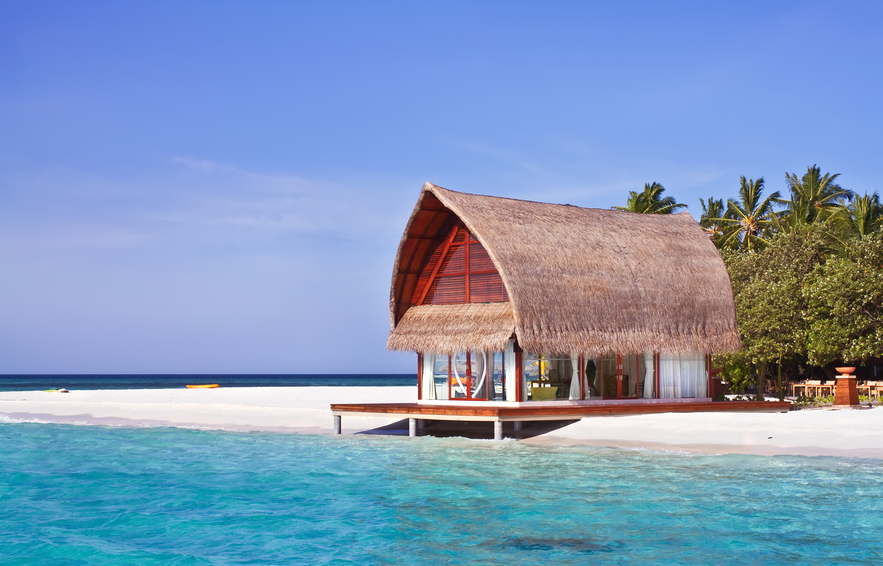 Thatch roof house on the beach in the Maldives