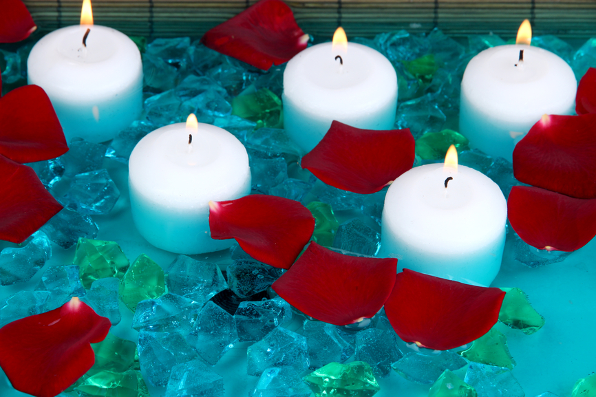 Candles floating in a pool