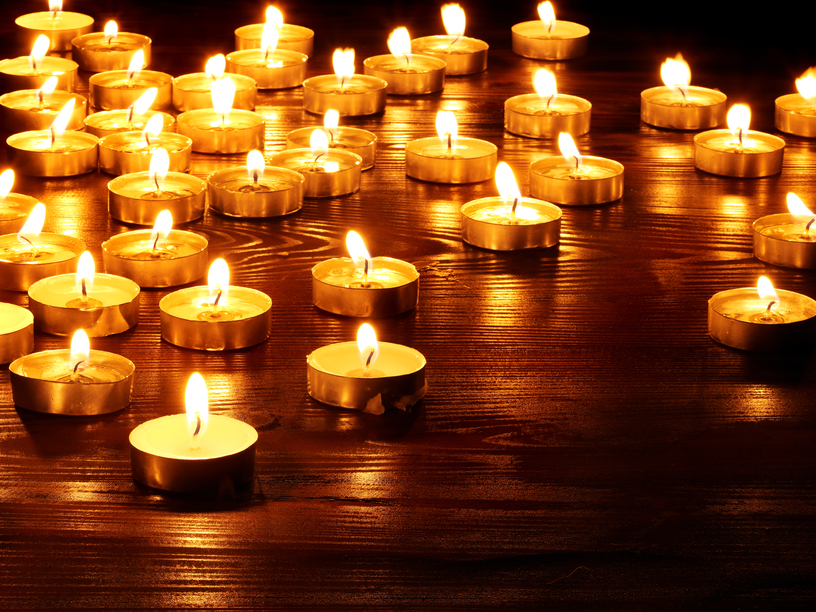 Large group of lit candles