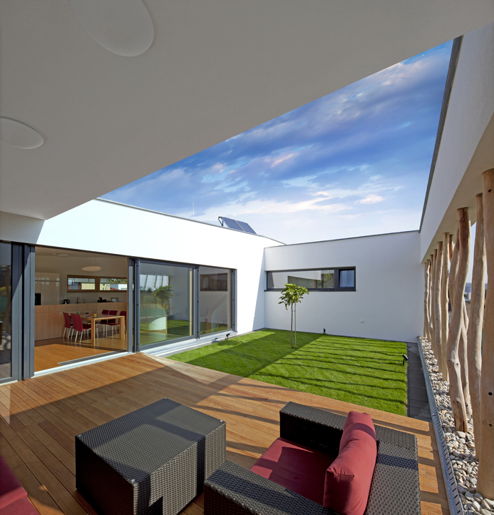 Sky view from grassed in courtyard in single family one-level home