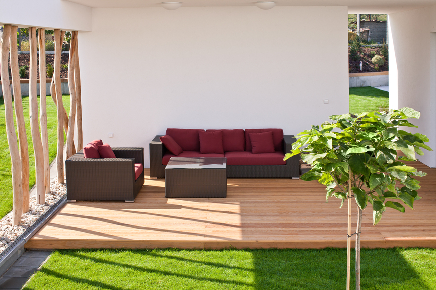 Comfortable Patio Furniture Edging Up To Grass Courtyard