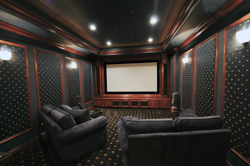 Classic dark home theatre designed to emulate a real cinema