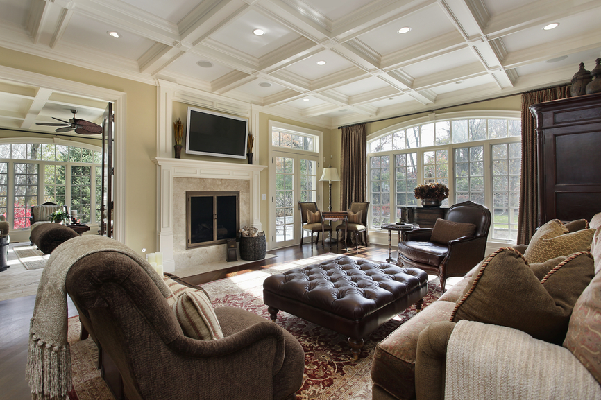 Family Room With Exposed White Ceiling Beams Beige Furniture Leather