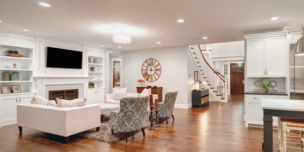 open concept floor plan with family room off the kitchen extensive white color scheme with