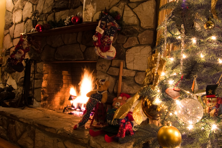 Fireplace with a Christmas tree and stone surround
