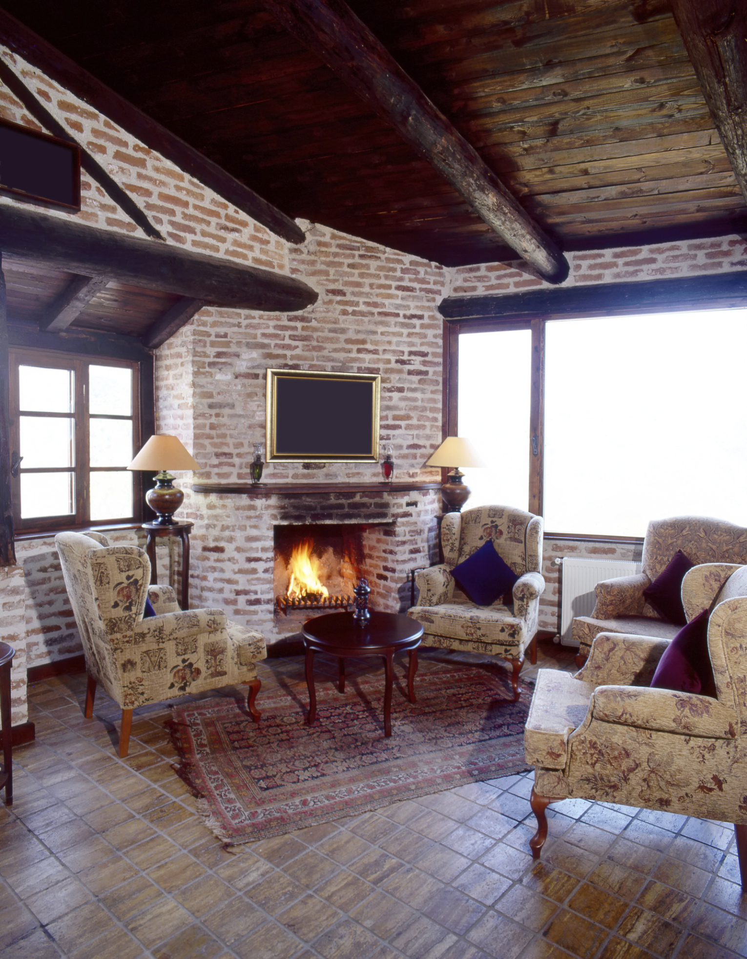 Brick Fireplace In A Rustic Room