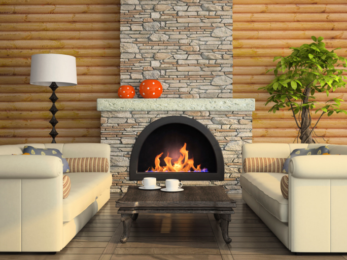 Stacked rock fireplace surround against log walls.