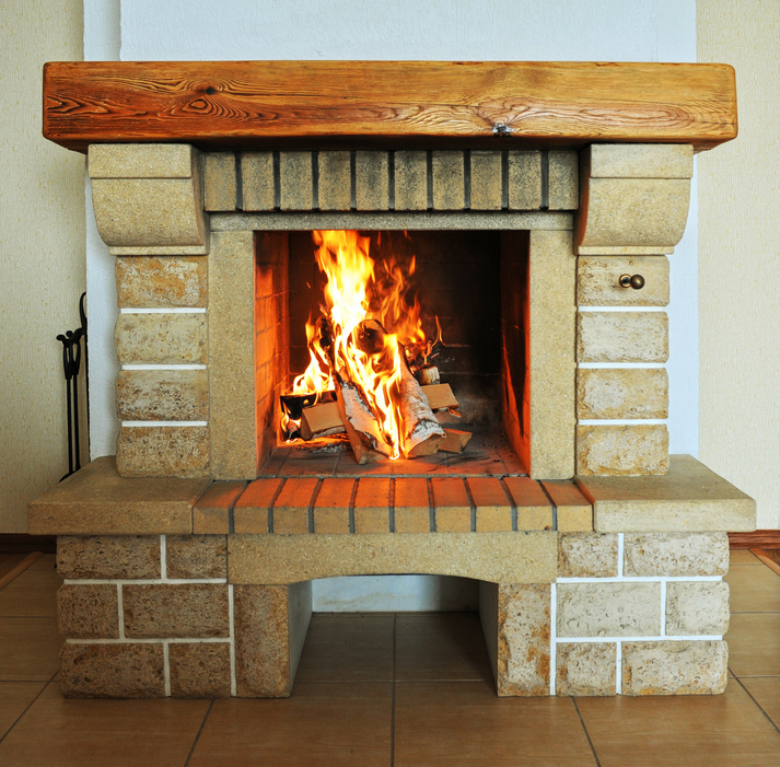 Brick fireplace with massive wood mantel.