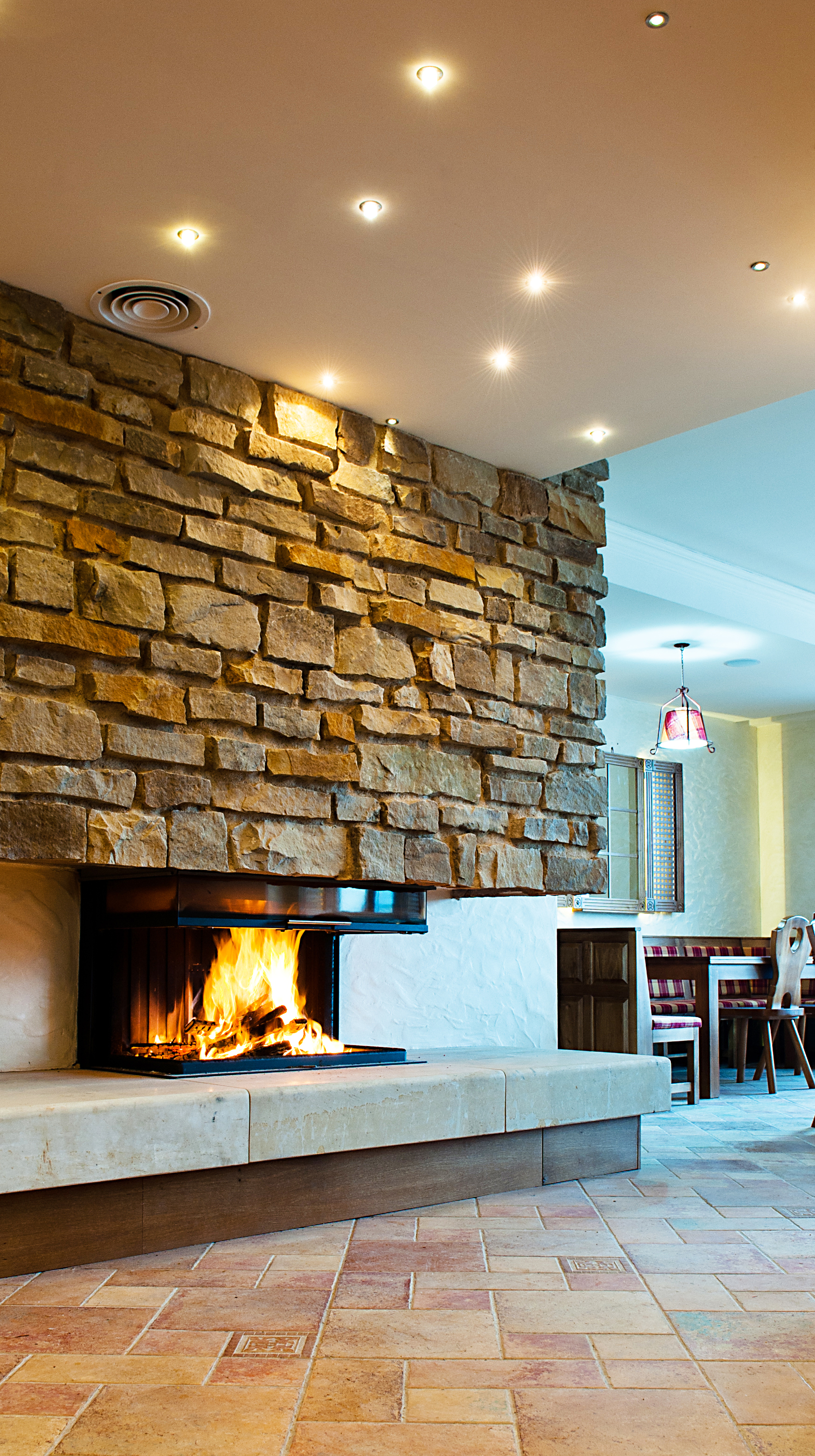 Fireplace with a stacked stone element above the hearth