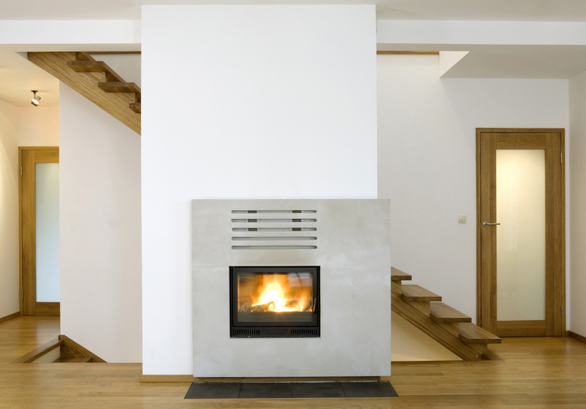 Modern fireplace against a set of stairs