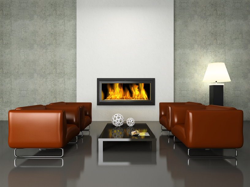 Contemporary fireplace with white surround and concrete walls