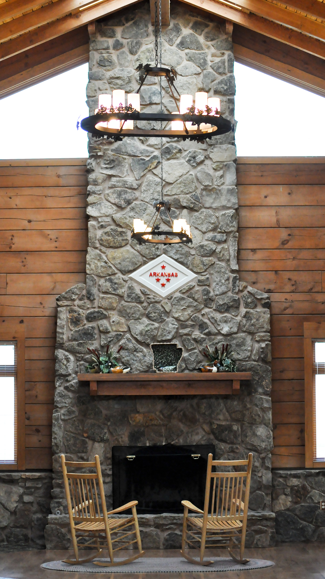 Granite Places Near Me : Concrete walls are offset by the white of the clean fireplace surround ...