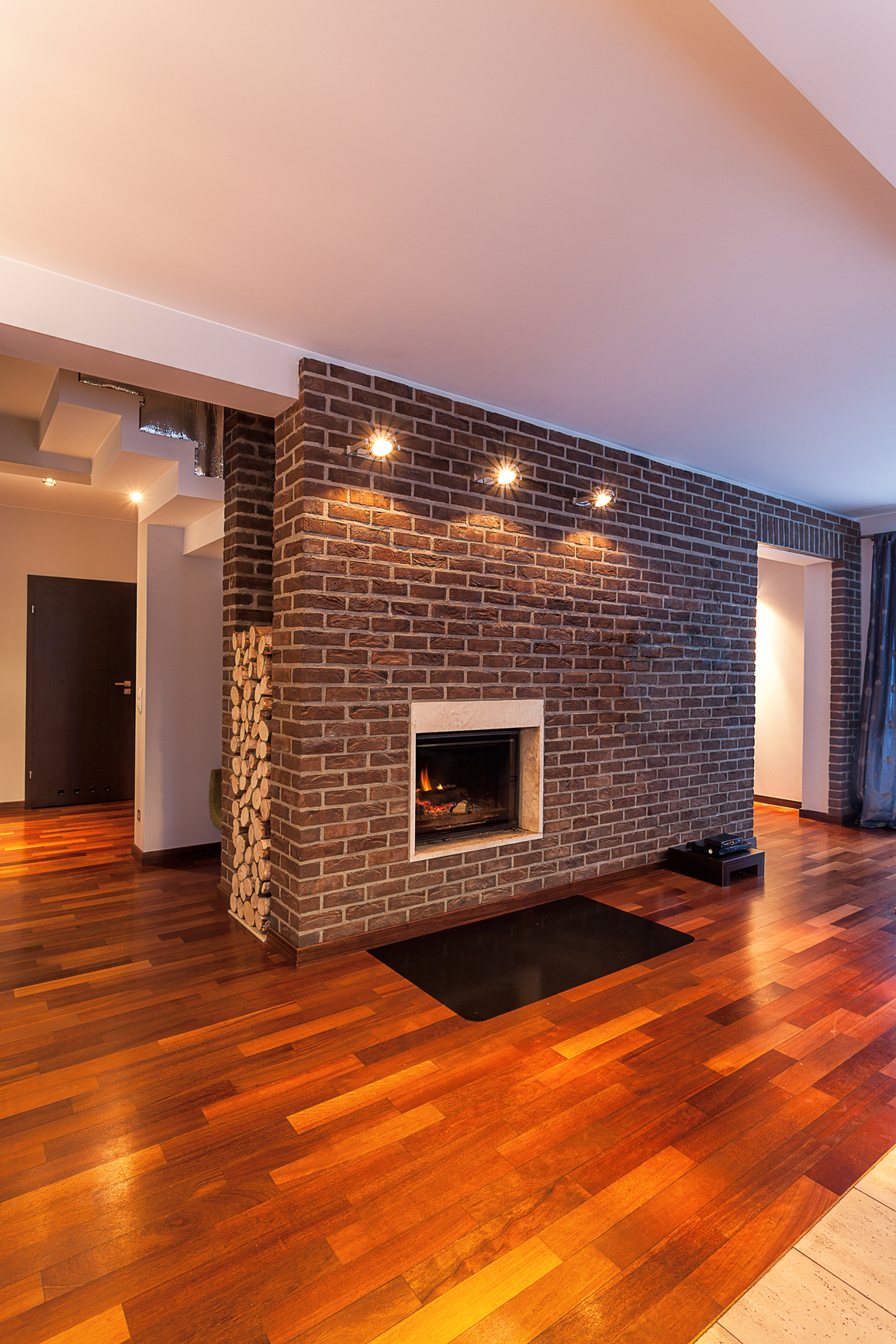 Brick fireplace with a modern twist