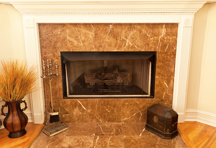 Gas fireplace with marble tile.