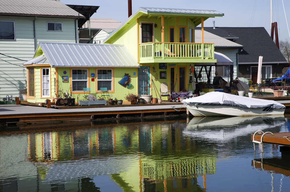 2 story green floating home in Portland Oregon