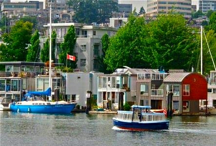 Floating homes in False Creek, Vancouver, BC with water taxi
