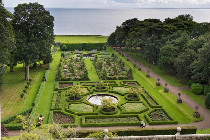 Extensive English Garden containing a wide variety of sculpted hedges, trees and plants