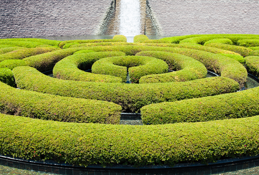 Circular-shaped hedge maze with the hedge itself sculpted into a cylinder
