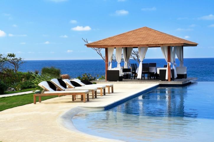 luxury square gazebo with white curtains on pool patio