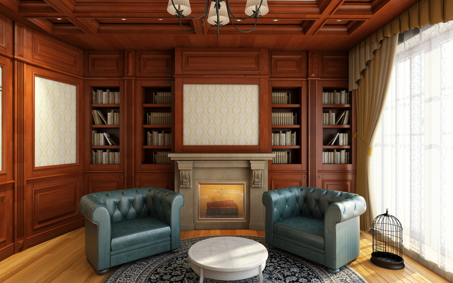 Sitting area in wood-paneled home office. Large blue leather chairs with white round coffee table in front of fireplace and built-in wood bookshelves