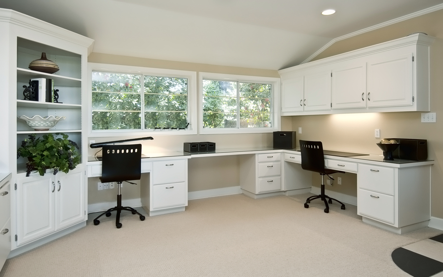 Expansive home office with built-in desks. 2 work stations as well as