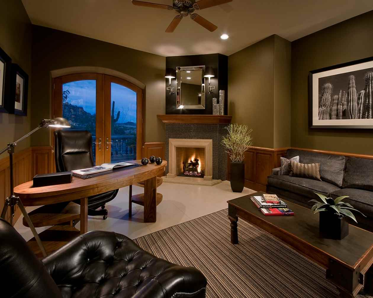 large luxury home office and den with fireplace wood desk and large