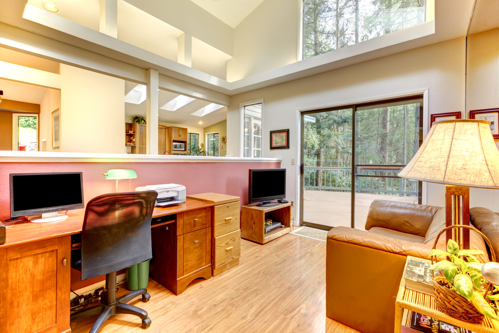 Two-story home office with plenty of natural light. One large desk plus television viewing area. Screened door leads to outdoor deck