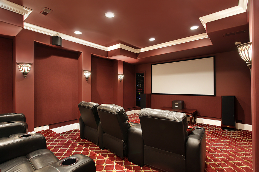 Ruby Red Designed Home Theater With Stadium Seating And Brown Leather Plush Theater  Seats.