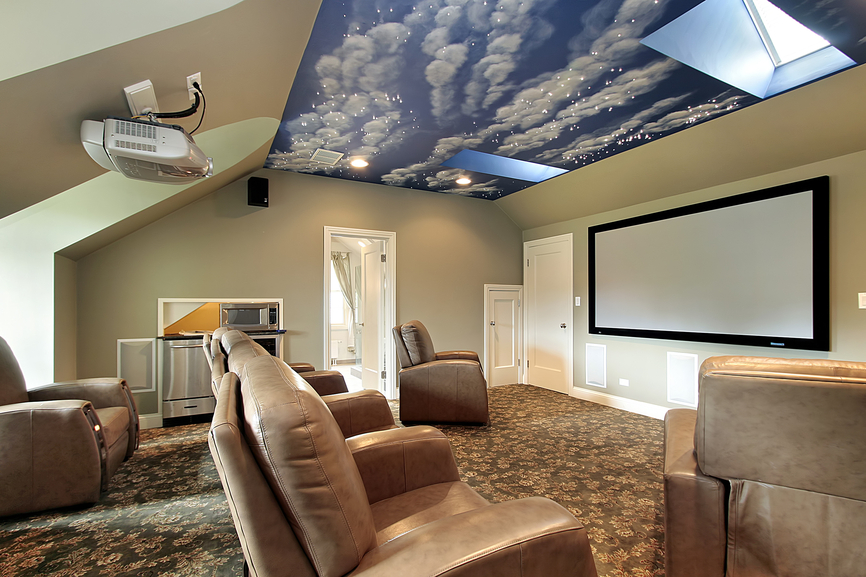 Home media room with individual beige leather recliners and sky-ceiling