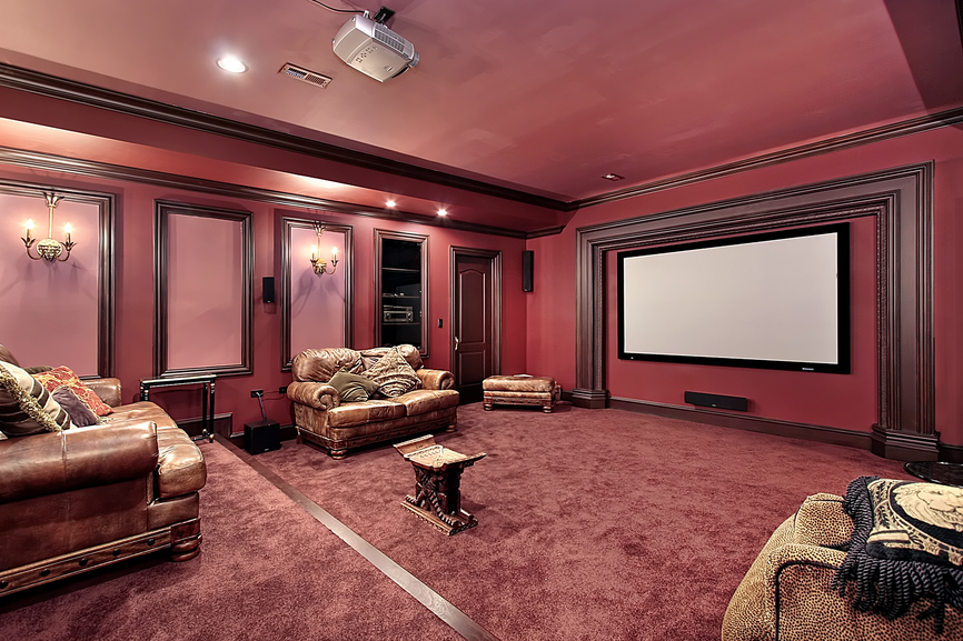 Large pink home cinema with rustic leather chairs and sofas