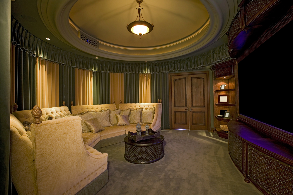 wood home theater room with a large semi circle sofa - Home Theater Room Design Ideas