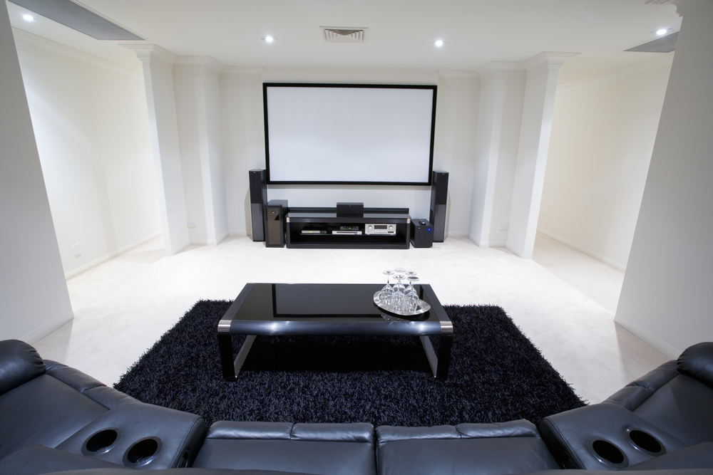 Stark white and black home theater with coffee table and black rug