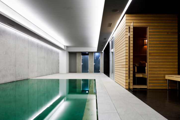 Modern home with indoor pool and sauna room. Great cement and wood design.