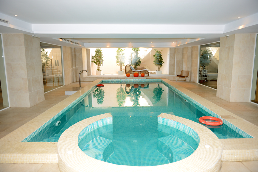 large indoor pool and hot tub complex with trees showcased on one end - Big Houses With Swimming Pools Inside
